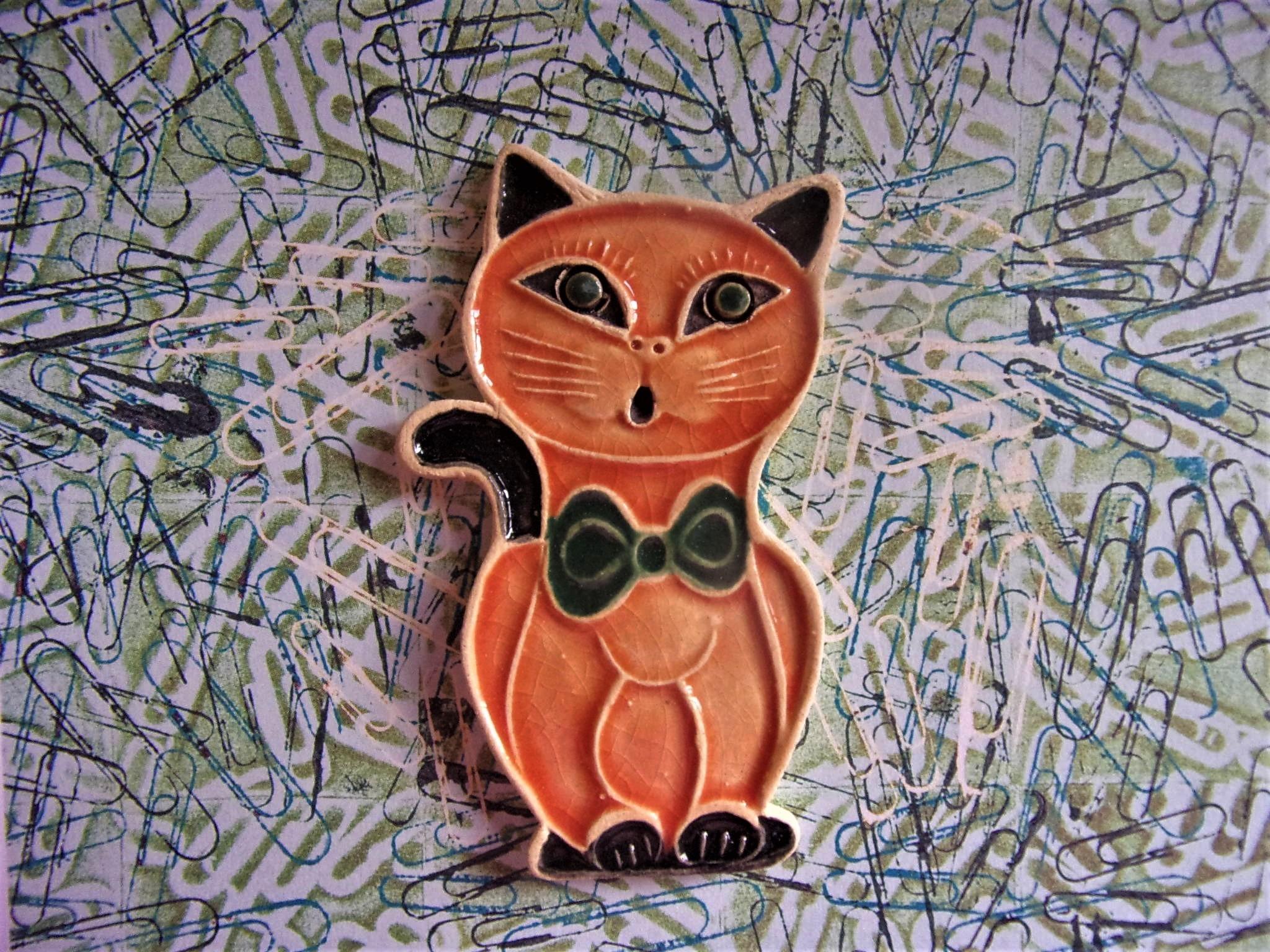 keramická kočka je vhodná jako drobný dárek, velikost je cca 5x7 cm